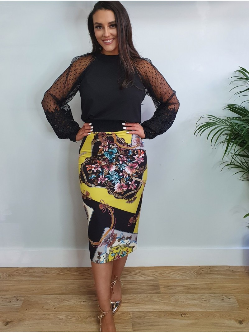 Allanah 2 piece top with crochet detail and long lace bell sleevesand pencil skirt in lime green print from Arggido Spain